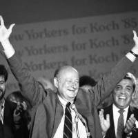 Photo - In this Sept. 11, 1985 file photo, New York Mayor Ed Koch raises his arms in victory at the Sheraton Centre in New York after winning the Democratic primary in his bid for a third four-year term.   Koch died Friday, Feb. 1, 2013 from congestive heart failure, spokesman George Arzt said. He was 88. (AP Photo/Mario Suriani, file)
