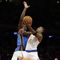 Photo - New York Knicks' J.R. Smith (8) drives past Oklahoma City Thunder's Serge Ibaka during the first half of an NBA basketball game Thursday, March 7, 2013, in New York.  (AP Photo/Frank Franklin II)