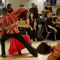 Photo - A crowd watches the Life Change Ballroom Dancers perform Friday, Oct. 19, 2012, at the Oklahoma City Swing Club. Photo by Bryan Terry, The Oklahoman  BRYAN TERRY - THE OKLAHOMAN