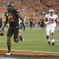 Photo - Oklahoma State's Justin Blackmon (81) scores a touchdown in  front of Delano Howell (26) during the Fiesta Bowl between the Oklahoma State University Cowboys (OSU) and the Stanford Cardinal at the University of Phoenix Stadium in Glendale, Ariz., Monday, Jan. 2, 2012. Photo by Bryan Terry, The Oklahoman