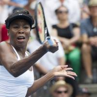 Photo - Venus Williams of the U.S. plays a shot against Serbia's Ana Ivanovic in the singles final at the ASB Classic women's tennis tournament at ASB Tennis Arena, in Auckland, New Zealand, Saturday, Jan. 4, 2014. (AP Photo/SNPA, David Rowland) NEW ZEALAND OUT