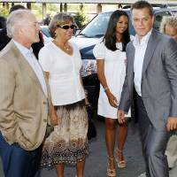 Photo - Actor Matt Damon, right, and producer Frank Marshall, left, along with Damon's mother, Nancy Carlsson-Paige, second from left, and Damon's wife, Luciana Barroso, arrive at the Oklahoma City movie premiere of