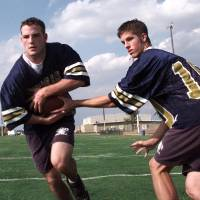 Photo - Heritage Hall football players Wes Welker and Graham Colton
