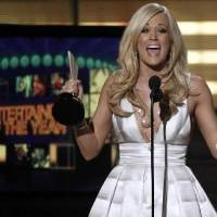 Photo - Carrie  Underwood accepts the award for Entertainer of the Year at the 45th Annual Academy of Country Music Awards in Las Vegas on Sunday, April 18, 2010. AP Photo