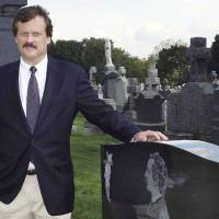 Photo -   FILE - In this Oct. 1, 2006 file photo, author William B. Styple poses next to the grave of Civil War artist-writer James Edward Kelly at a cemetery in New York. Styple's latest book,
