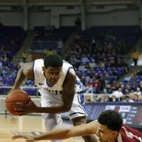 Photo - TCU guard Jarvis Ray (22) grabs the ball away from Oklahoma guard Frank Booker (1) in the second half of an NCAA basketball game Saturday, March 8, 2014, in Fort Worth, Texas. Oklahoma won 97-67. (AP Photo/Sharon Ellman)