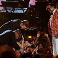 Photo -  From left, Pharrell Williams, Justin Timberlake and Charlie Wilson are shown onstage at the BET Awards at the Nokia Theatre on Sunday, June 30, 2013, in Los Angeles. (AP)