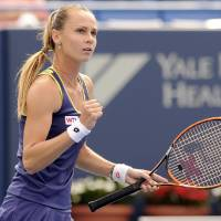 Photo - Magdalena Rybarikova, of Slovakia, celebrates during a quarterfinal match against Alison Riske at the New Haven Open tennis tournament in New Haven, Conn., on Thursday, Aug. 21, 2014. (AP Photo/Fred Beckham)