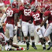 Photo -   FILE - In this Sept. 8, 2012, file photo, Alabama's n Quinton Dial (90), defensive lineman Brandon Ivory (62), linebacker C.J. Mosley (32) and linebacker Nico Johnson (35) celebrate after sacking Western Kentucky quarterback Kawaun Jakes (6) during the first half of an NCAA college football game at Bryant Denny Stadium in Tuscaloosa, Ala. Coach Nick Saban says Mosley has gotten bigger and stronger and improved against the run but is especially strong in coverage. Saban says Mosley has been the most productive player on the nation's No. 1 scoring defense. (AP Photo/Dave Martin)