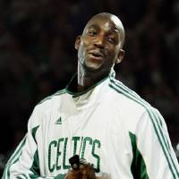 Photo - Kevin Garnett of the Boston Celtics reacts as he receives his NBA Championship ring during ceremonies prior to an NBA basketball game against the Cleveland Cavaliers in Boston on Tuesday, Oct. 28, 2008. The Celtics defeated the Lakers to win the 2008 championship. (AP Photo/Winslow Townson) ORG XMIT: MAEA104