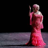 Photo - Dot Liles of Oklahoma City waves to the crowd during the evening dress portion of the Ms. Oklahoma Senior America Pageant on Saturday. Photo by Bryan Terry, The Oklahoman  Bryan Terry - THE OKLAHOMAN