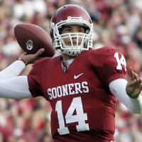 Photo - FILE - In this Oct. 29, 2009, file photo, Oklahoma quarteback Sam Bradford throws  during an NCAA college football game against Baylor in Norman, Okla. Bradford is a top prospect in the NFL draft. (AP Photo/Sue Ogrocki, File) ORG XMIT: ny203