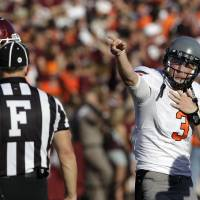 Photo - Oklahoma State quarterback Brandon Weeden (3) signals a first down after a penalty call against Texas A&M during the fourth quarter of an NCAA college football game Saturday, Sept. 24, 2011, in College Station, Texas. Oklahoma State beat Texas A&M 30-29. (AP Photo/David J. Phillip) ORG XMIT: TXDP124