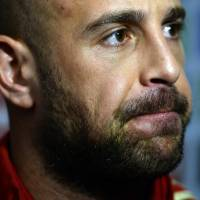 Photo - Spain's goalkeeper Pepe Reina listens to the media at the Atletico Paranaense training center in Curitiba, Brazil, Sunday, June 15, 2014. Spain will play in group B of the Brazil 2014 World Cup. (AP Photo/Manu Fernandez)