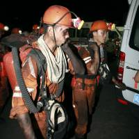 Photo -   In this photo released by China's Xinhua News Agency, rescuers work at Xiaojiawan Coal Mine in Panzhihua City, southwest China's Sichuan Province, Thursday, Aug. 30, 2012. A gas explosion at the mine killed over a dozen miners and trapped dozens more, state media reported Thursday. (AP Photo/Xinhua, Zhang Zhong) NO SALES