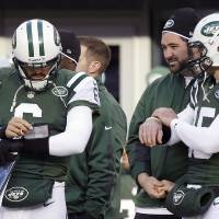 Photo - New York Jets quarterbacks Mark Sanchez (6) and Tim Tebow (15) stand next to each other on the sideline during the first half of an NFL football game against the San Diego Chargers, Sunday, Dec. 23, 2012, in East Rutherford, N.J. (AP Photo/Kathy Willens)