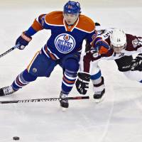 Photo - Edmonton Oilers' Nail Yakupov, left, battles for the puck with Colorado Avalanche's Paul Stastnyduring the second period of their NHL hockey game, Monday, Jan. 28, 2013, in Edmonton, Alberta. (AP Photo/The Canadian Press, Jason Franson)