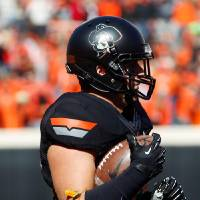 Photo -  All-Black jersey combo for Oklahoma State today, complete with the Phantom Pete helmet logo
