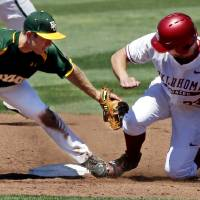 Photo - Oklahoma's Kolbey Carpenter (23) is safe beating the tag of Baylor's Hayden Ross (45) as the University of Oklahoma Sooner (OU) baseball team plays the Baylor Bears in college baeball at L. Dale Mitchell Park on May 3, 2014 in Norman, Okla. Photo by Steve Sisney, The Oklahoman