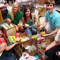Photo - Edmond Santa Fe and North high school students recently collected more than 50 boxes of food for tornado victims. Pictured from left are Santa Fe students Cody Turner, Julie Stockton and Megan Turner, and North students Brett Holleman and Charles Anderson. PHOTO PROVIDED BY EARL KIRKPATRICK, NEWSOK.COM