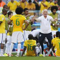 Photo - Brazil's coach Luiz Felipe Scolari gives instructions to his players before the extra time during the World Cup round of 16 soccer match between Brazil and Chile at the Mineirao Stadium in Belo Horizonte, Brazil, Saturday, June 28, 2014. (AP Photo/Frank Augstein)