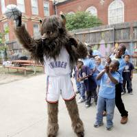 Photo - NBA OKC Thunder basketball mascot Rumble the Bison shoots a basketball in front of children during a birthday party at Positive Tomorrows in Oklahoma City, Thursday, September 24, 2009. Photo by Nate Billings, The Oklahoman ORG XMIT: KOD