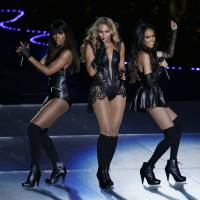 Photo - Beyonce performs with Kelly Rowland, left, and Michelle Williams, right, of Destiny's Child, during the halftime show of the NFL Super Bowl XLVII football game between the San Francisco 49ers and the Baltimore Ravens, Sunday, Feb. 3, 2013, in New Orleans. (AP Photo/Gerald Herbert)