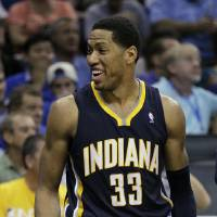 Photo -   Indiana Pacers' Danny Granger jokes with teammates as he rest on the bench during the fourth quarter of Game 3 of an NBA first-round playoff basketball series against the Orlando Magic, Wednesday, May 2, 2012, in Orlando, Fla. Indiana won 97-74. (AP Photo/John Raoux)