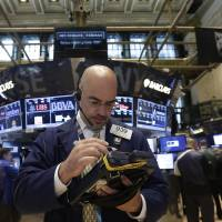 Photo - Trader Luigi Muccitelli works on the floor of the New York Stock Exchange Monday, June 23, 2014. Stocks are edging lower in early trading after indexed closed last week at record highs. (AP Photo/Richard Drew)