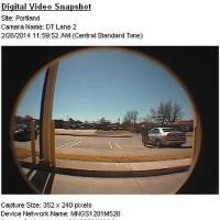 Photo -  Surveillance video of the vehicle the suspect used during a bank robbery. The man was seen entering a silver, four-door Honda Accord and drove west on NW 22. Photo provided by the FBI    -  Provided by the FBI