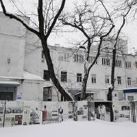 """Photo - People walk in front of Warsaw's Jewish community center, known as the """"white building"""" in Warsaw, Poland, Friday, Jan. 25, 2013. The building, one of the few surviving remnants of the infamous Warsaw Ghetto, could be torn down to make way for a taller modern building, a plan that has angered advocates of historic preservation and sparked a battle to save the structure. The Jewish community defends the plan, saying it needs to build a larger and newer building on the spot to accommodate a growing community. (AP Photo/Czarek Sokolowski)"""