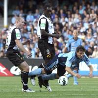 Photo -   Sydney FC's Alessandro Del Piero, right, falls after being tackled by Newcastle Jets' Craig Goodwin, left, and Emile Heskey during their A-league soccer match in Sydney, Australia, Saturday, Oct. 13, 2012. (AP Photo/Rob Griffith)