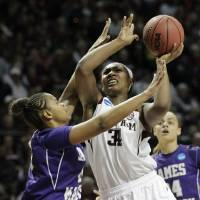 Photo - 3Texas A&M center Karla Gilbert (34) takes a shot over James Madison forward Da'Lishia Griffin during the first half of an NCAA women's basketball game, Tuesday, March 25, 2014, in College Station, Texas. (AP Photo/Patric Schneider)
