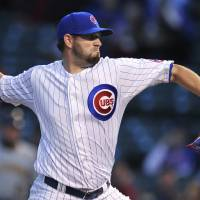 Photo - Chicago Cubs starter Jason Hammel delivers a pitch during the first inning of a baseball game against the Pittsburgh Pirates in Chicago, Wednesday, April 9, 2014. (AP Photo/Paul Beaty)
