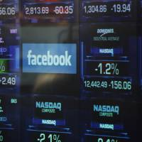Photo -   The Facebook logo appears on a display inside the NASDAQ Marketsite in Times Square Thursday, May 17, 2012, in New York. Facebook priced its IPO at $38 per share on Thursday, at the high end of its expected range. If extra shares reserved to cover additional demand are sold as part of the transaction, Facebook Inc. and its early investors stand to reap as much as $18.4 billion from the IPO. (AP Photo/Frank Franklin II)