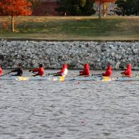 Photo - The crew from US Grant High School heads to the finish line to win their 500 meter heat race in a time of 2:04 in during the OKC Riversport Youth League Championship on the Oklahoma River in downtown Oklahoma City, Wednesday, November 16, 2011. PHOTO BY HUGH SCOTT, FOR THE OKLAHOMAN