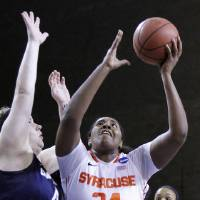 Photo - Syracuse's Shakeya Leary (34) shoots as Chattanooga's Ashlen Dewart defends during the first half of a first-round NCAA college basketball game in Lexington, Ky., Saturday, March 22, 2014. (AP Photo/James Crisp)