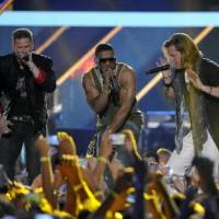 Photo -  Brian Kelley, left, and Tyler Hubbard, right, of musical group Florida Georgia Line, and Nelly perform at the 2013 CMT Music Awards at Bridgestone Arena on Wednesday, June 5, 2013, in Nashville, Tenn. (AP)