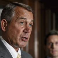 Photo - FILE - This Jan. 28, 2014 file photo shows House John Boehner of Ohio, accompanied by House Majority Leader Eric Cantor of Va. speaking at Republican National Committee headquarters in Washington. House Republican leaders challenged President Barack Obama on Thursday to override the opposition of the Senate's top Democrat and help pass trade legislation the administration favors.