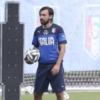 Photo - Italy's Andrea Pirlo stands on the pitch at a training session in Mangaratiba, Brazil, Wednesday, June 11, 2014. Italy will play in group D of the Brazil 2014 soccer World Cup. (AP Photo/Antonio Calanni)