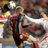 Photo -   Real Salt Lake's Nat Borchers, center, looks to score under pressure from C.S. Herediano's Pablo Salazar and Cristian Montero during their CONCACAF soccer match, Tuesday, Oct. 23, 2012, in Sandy, Utah. (AP Photo/The Deseret News, Brian Nicholson) SALT LAKE TRIBUNE OUT; PROVO DAILY HERALD OUT; MAGS OUT