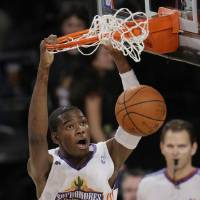 Photo - DUNK: Oklahoma City Thunder sophomore guard Kevin Durant (35) dunks against the rookie squad during the first half of the All-Star Rookie Challenge NBA basketball game, Friday, Feb. 13, 2009, in Phoenix. (AP Photo/Matt Slocum) ORG XMIT: AZRH108
