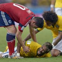 Photo - Brazil's Neymar screams out after being fouled during the World Cup quarterfinal soccer match between Brazil and Colombia at the Arena Castelao in Fortaleza, Brazil, Friday, July 4, 2014. (AP Photo/Manu Fernandez)