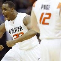 Photo - Oklahoma State's Roger Franklin (32) reacts after a Cowboy basket against Oklahoma. Photo by Chris Landsberger, The Oklahoman