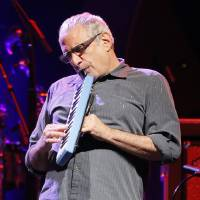 Photo -  Donald Fagen plays the melodica as Steely Dan performs Monday at the Chesapeake Energy Arena in Oklahoma City. Photo by Nate Billings, The Oklahoman   NATE BILLINGS -