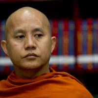 Photo - In this photo taken on March 27, 2013, Buddhist monk Wirathu sits in the library of the Ma Soe Yein monastery during an interview in Mandalay, Myanmar. The popular monk insists he is a man of peace, but has emerged as the spiritual leader of a pro-Buddhist fringe movement accused of fueling a bloody campaign of sectarian violence. Wirathu insists the world has misunderstood him.