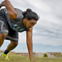 Photo - SUPER 30 / HIGH SCHOOL FOOTBALL PLAYER: Lawton Eisenhower High School's Michael Moana goes through summer football workouts at the school on Tuesday, June 18, 2013 in Lawton, Okla.   Photo by Chris Landsberger, The Oklahoman