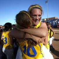 Photo -  Bethel's Makayla Green, right, and Megan Acklin celebrate following  the Class 5A slow-pitch high school softball state championship game between Bethel and Purcell, Wednesday, May 5, 2010, at ASA Hall of Fame Stadium in Oklahoma City. Photo by Sarah Phipps, The Oklahoman.       ORG XMIT: KOD