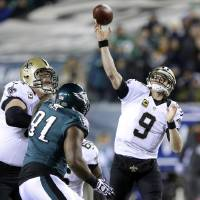 Photo - New Orleans Saints' Drew Brees (9) passes during the first half of an NFL wild-card playoff football game against the Philadelphia Eagles, Saturday, Jan. 4, 2014, in Philadelphia. (AP Photo/Michael Perez)