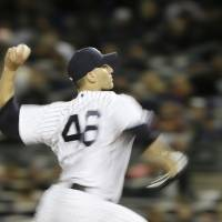 Photo -   New York Yankees' Andy Pettitte throws in the second inning during Game 1 of the American League championship series against the Detroit Tigers Saturday, Oct. 13, 2012, in New York. (AP Photo/Matt Slocum)